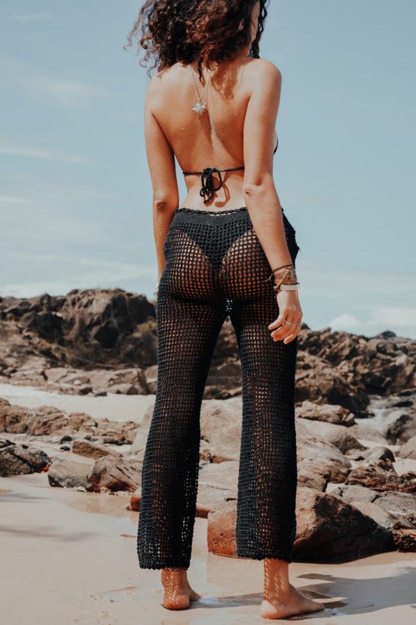 neela pantalon black vue dos plage